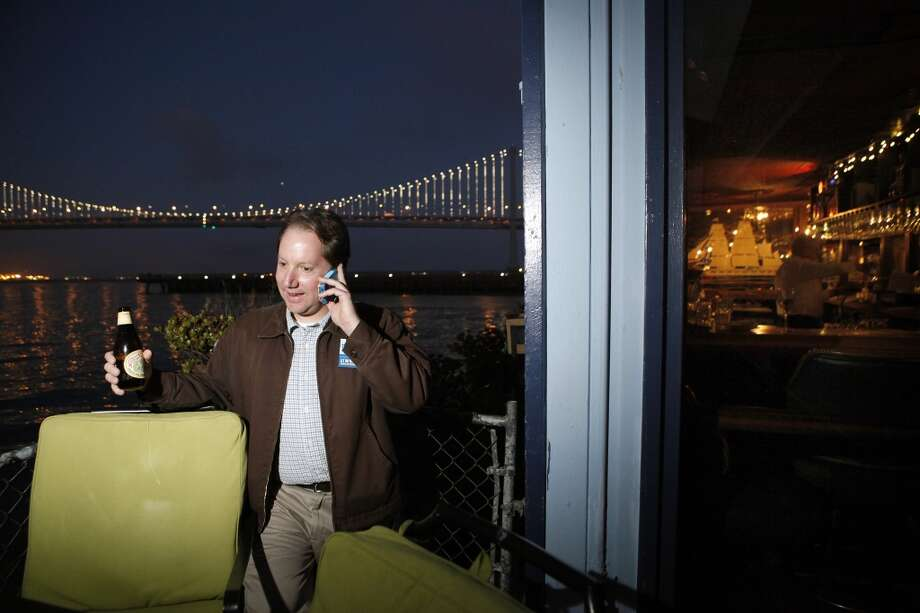 Yes on Prop. B Campaign Manager Jon Golinger takes a phone call as supporters gather for a party at Sinbad's Restaurant on Pier 2 in San Francisco, CA, Tuesday June 3, 2014. Photo: Michael Short, The Chronicle