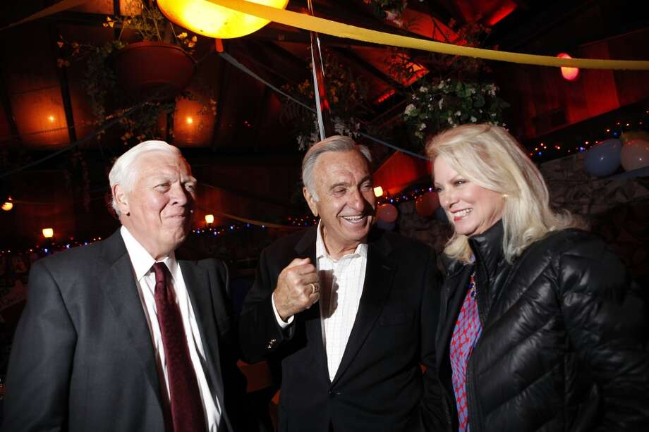 Former San Francisco Mayor Art Agnos, center, talks with Bob and Chandra Friese of San Francisco Beautiful as supporters of Proposition B gather for a party at Sinbad's Restaurant on Pier 2 in San Francisco, CA, Tuesday June 3, 2014. Photo: Michael Short, The Chronicle