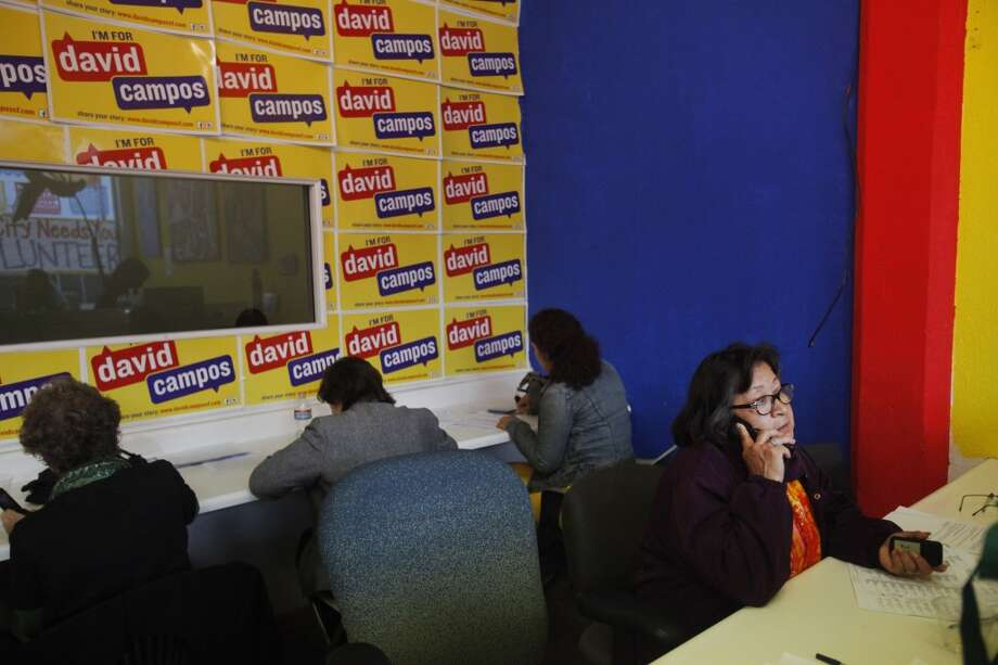 Volunteer Maria Ramos, right, makes last-minute phone calls to voters with other volunteers for David Campos for the State Assembly primary June 3, 2014 at the Campos campaign headquarters in San Francisco, Calif. Photo: The Chronicle