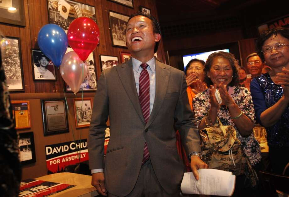David Chiu smiles as he's introduced to a crowd of cheering volunteers, friends, family and community members to give a speech after results indicated him winning the State Assembly primary June 3, 2014 at Lefty OÕDoulÕs in San Francisco, Calif. Photo: The Chronicle