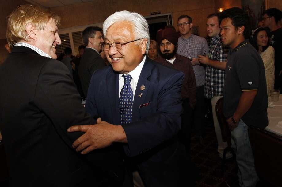 Congressman Mike Honda greets supporters as he arrives at his election party at Massimo's in Fremont, Calif., on Tuesday, June 3, 2014. Photo: Special To The Chronicle