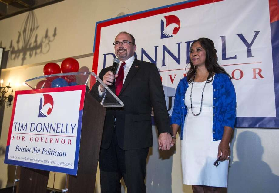California Republican gubernatorial candidate Tim Donnelly with his wife Rowena, speaks to supporters while they are waiting for the result at his election night party in Hollywood, section of Los Angeles, Tuesday, June 3, 2014. Photo: Ringo H.W. Chiu, Associated Press