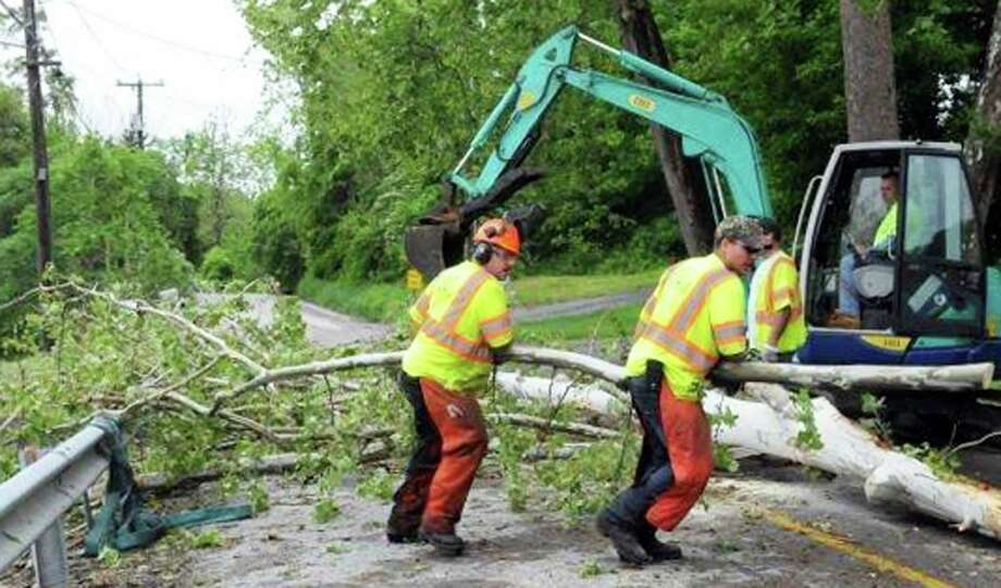 New Milford town workers clear Van Car Road of fallen branches and other debris after May 27's strong storm in New Milford. May 2014 Photo: Carol Kaliff / The News-Times