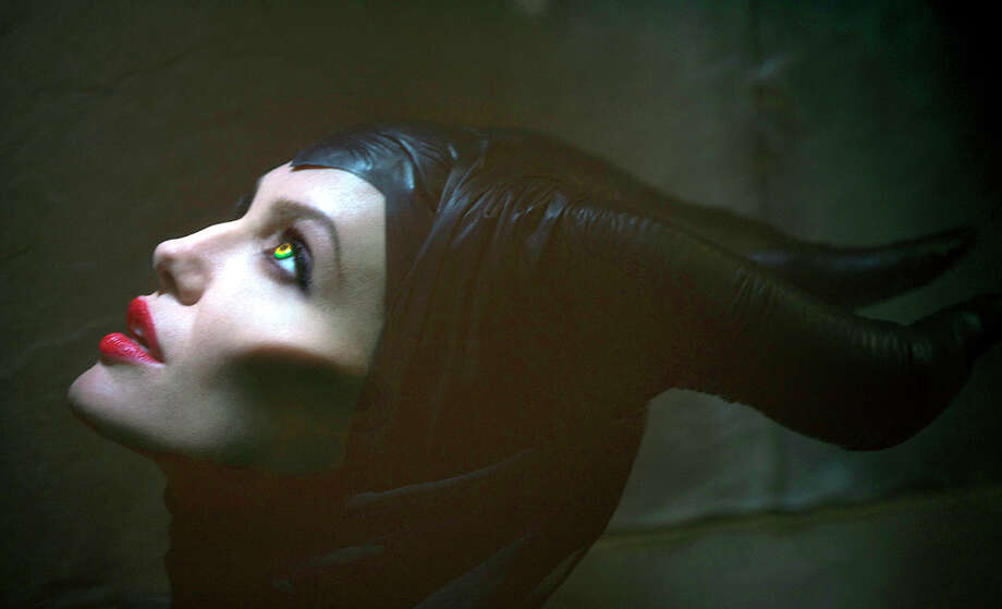 "This June 14, 2012 image released by Disney Enterprises, Inc., shows actress Angelina Jolie in the title role of ""Maleficent,"" the villain from the 1959 classic ""Sleeping Beauty."" The film releases in theaters in the U.S. on May 30, 2014. (AP Photo/Disney Enterprises, Inc., Greg Williams) Photo: Greg Williams, HOEP / Disney Enterprises, Inc."