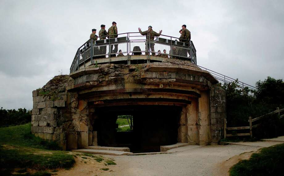 Dutch soldiers tour the massive gun emplacements that held 155mm guns at Point du Hoc June 3, 2014 in Point du Hoc, France. June 6th is the 70th anniversary of the D-Day landings which saw 156,000 troops from the allied countries including the United States and the United Kingdom join forces to launch an attack on the beaches of Normandy, these assaults are credited with the eventual defeat of Nazi Germany. A series of events commemorating the 70th anniversary is planned for the week with many heads of state traveling to the famous beaches to pay their respects to those who lost their lives. Photo: Win McNamee, Getty Images / 2014 Getty Images