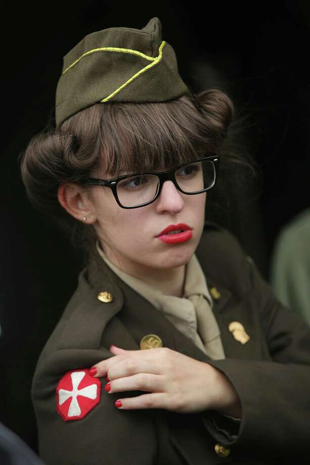 A female historical D-Day re-enactment enthusiast dressed as an American military secretary attends a re-enactment camp on June 4, 2014 in Sainte Mere Eglise, France. Friday the 6th of June is the 70th anniversary of the D-Day landings that saw 156,000 troops from the Allied countries, including the United Kingdom and the United States, join forces to launch an audacious attack on the beaches of Normandy,  these assaults are credited with the eventual defeat of Nazi Germany. A series of events commemorating the 70th anniversary are planned for the week with many heads of state traveling to the famous beaches to pay their respects to those who lost their lives. Photo: Sean Gallup, Getty Images / 2014 Getty Images