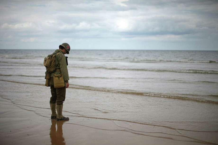 World War II re-enactors  practice for the 70th anniversary of D-Day on Omaha Beach on June 3, 2014 in Vierville-sur-Mer, France. Friday 6th June is the 70th anniversary of the D-Day landings which saw 156,000 troops from the allied countries including the United Kingdom and the United States join forces to launch an audacious attack on the beaches of Normandy,  these assaults are credited with the eventual defeat of Nazi Germany. A series of events commemorating the 70th anniversary are planned for the week with many heads of state traveling to the famous beaches to pay their respects to those who lost their lives. Photo: Christopher Furlong, Getty Images / 2014 Getty Images