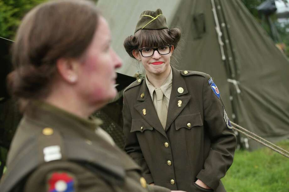 Female historical D-Day re-enactment enthusiasts dressed as American service women attend a re-enactment camp on June 4, 2014 in Sainte Mere Eglise, France. Friday the 6th of June is the 70th anniversary of the D-Day landings that saw 156,000 troops from the Allied countries, including the United Kingdom and the United States, join forces to launch an audacious attack on the beaches of Normandy,  these assaults are credited with the eventual defeat of Nazi Germany. A series of events commemorating the 70th anniversary are planned for the week with many heads of state traveling to the famous beaches to pay their respects to those who lost their lives. Photo: Sean Gallup, Getty Images / 2014 Getty Images