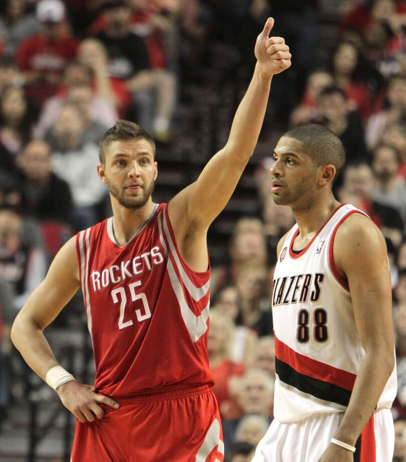 Houston Rockets forward Chandler Parsons (25) gives a thumbs up as he walks past Portland Trail Blazers forward Nicolas Batum (88) during the second quarter of game six of the Western Conference Quarterfinals playoffs at the Moda Center Friday, May 2, 2014, in Portland. ( James Nielsen / Houston Chronicle ) Photo: James Nielsen, Houston Chronicle