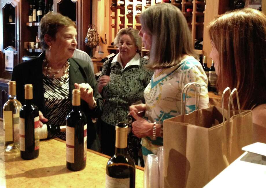 "Frances Mayes, left, the author of the best-selling memoir, ""Under the Tuscan Sun,"" came to the Twisted Vine on Post Road last week to introduce her new line of Italian wines. Photo: Patti Woods / Fairfield Citizen"