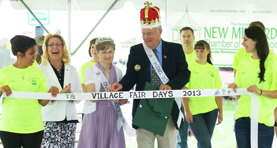 The King and Queen of the 2013 Village Fair Days - Pat and  Mary Maguire - cut the ceremonial ribbon to open the festivities as Mayor Pat Murphy, second from the left, and fair volunteers look on. Photo: Trish Haldin / The News-Times Freelance