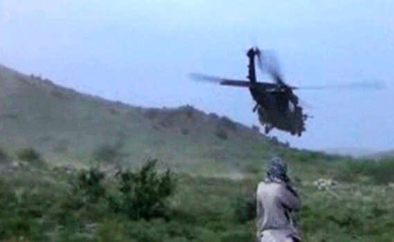 In this image taken from video obtained from Voice Of Jihad Website, which has been authenticated based on its contents and other AP reporting, A Taliban fighter looks at the helicopter carrying Sgt. Bowe Bergdahl taking off in eastern Afghanistan. The Taliban on Wednesday, June 4, 2014 released a video showing the handover of Bergdahl to U.S. forces in eastern Afghanistan, touting the swap of the American soldier for five Taliban detainees from Guantanamo as a significant achievement for the insurgents. Photo: Uncredited, AP / Voice Of Jihad Website