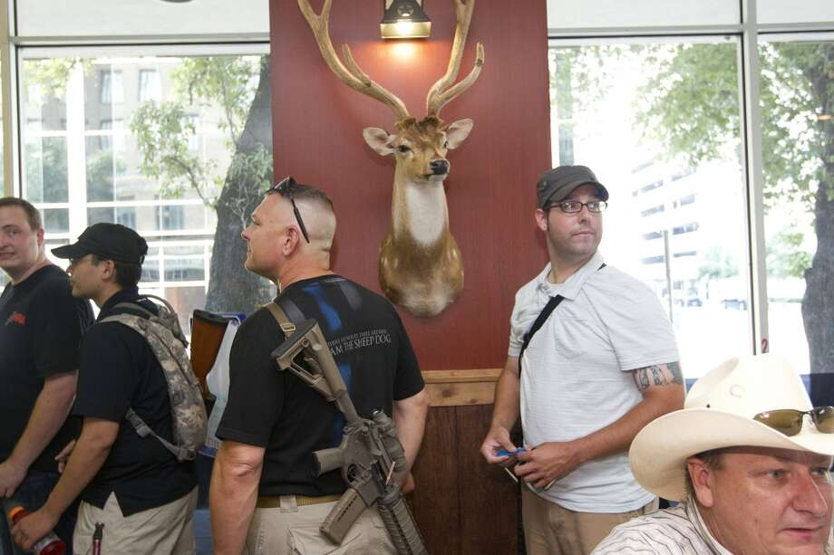 "After walking with their guns through downtown as part of a pro-gun rally, the group of about 25 people with the organization, Come and Take it Houston, ate lunch at Tony's BBQ & Steak House, which they said was a gun-friendly establishment Thursday, July 4, 2013, in Houston.  ""This is a Come and Take it Houston walk to help inform citizens about the gun laws here in Texas,"" co-orginizer Kenneth Lindbloom said. ""In Texas there are no restrictions on the open cary of long arms like rifles and shotguns and we want people to realize that in the hands of good people, guns are not dangerous and they don't kill people. When good people have guns it serves as a deterrent to stop crime.""( Johnny Hanson / Houston Chronicle ) Photo: Houston Chronicle"