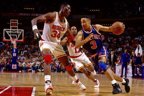 Game 7 - Wednesday, June 22, 1994Rockets 90, Knicks 84 Rockets win series 4-3  John Starks drives against Hakeem Olajuwon.