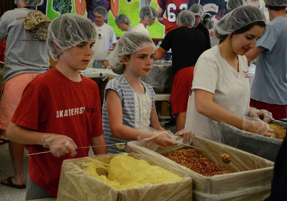 Volunteers of all ages helped pack 280,000 meals to feed starving children around the world during the fifth annual event organized by Feed My Staving Children and New Canaan's Pura Vida Club at the New Canaan High School, in New Canaan, Conn., Saturday and Sunday, May 31 and June 1, 2014. Photo: Nelson Oliveira / New Canaan News