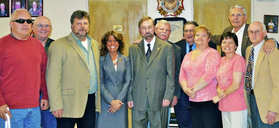 Chosen recently as officers for the next year for the New Miflord Lions Club are, from left to right, Larry Tracey, Jim Bannan, Bill Deak, Tammy Deak, President Steve Gallant, John Dunne, Bob Coppola, Katie Ducey, Trish Grinnell, Cliff Ricci and Charlie Chapin. May 2014  Courtesy of the New Milford Lions Club Photo: Contributed Photo / The News-Times Contributed