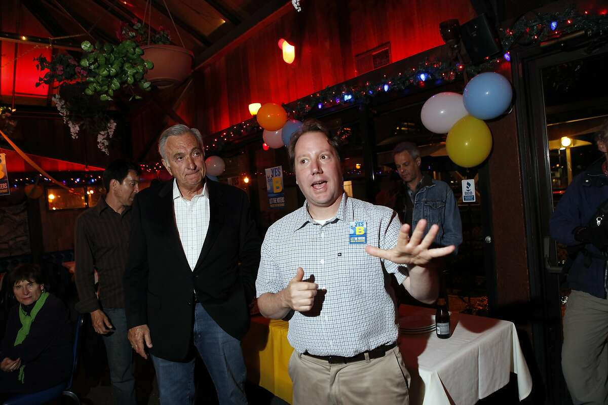 With Former San Francisco Mayor Art Agnos, left, listening, Proposition B Campaign Manager Jon Golinger gives a speech during a victory party at Sinbad's Restaurant on Pier 2 in San Francisco, CA, Tuesday June 3, 2014. Golinger argues the tower at 75 Howard Street should include on-site affordable housing.