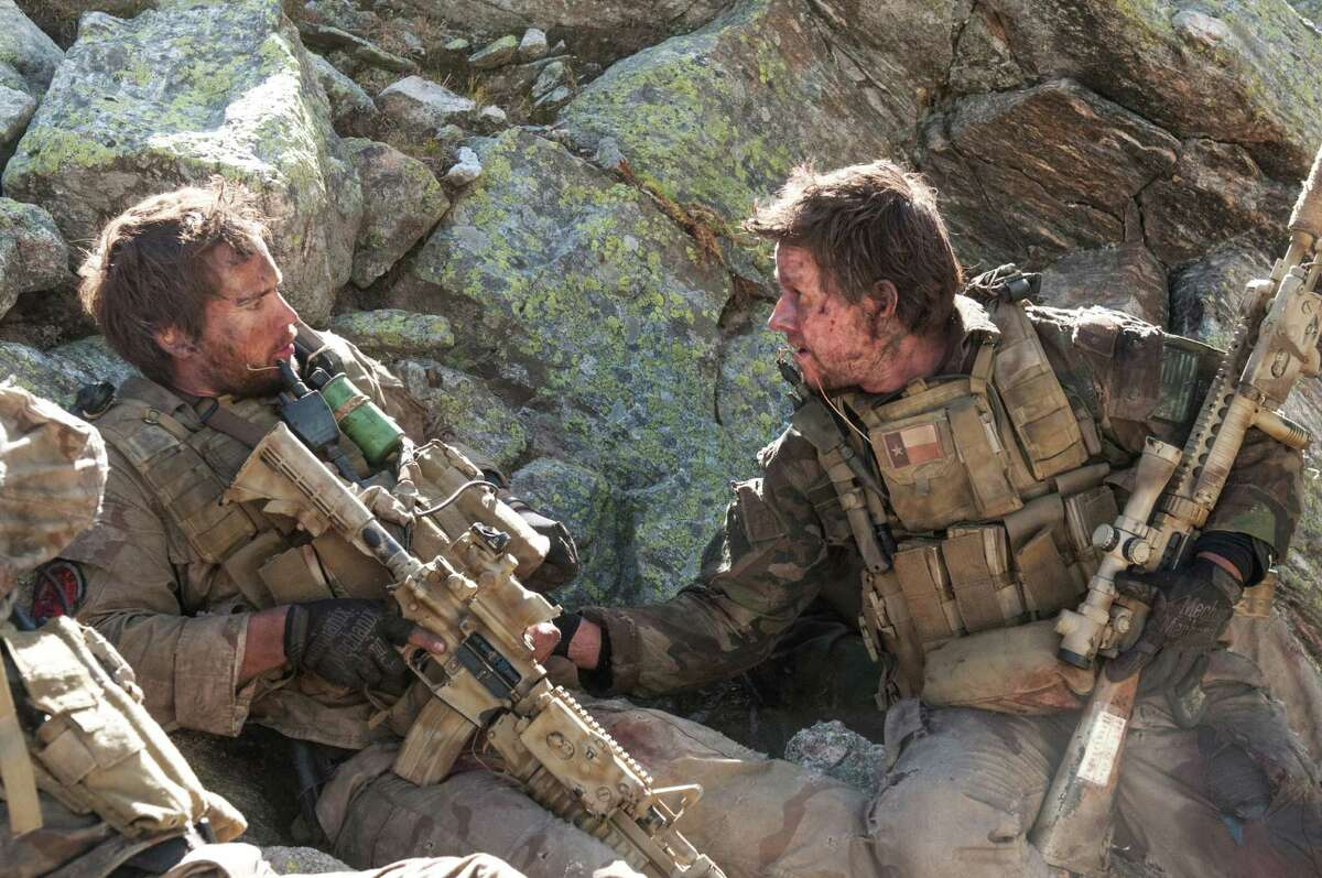 This photo released by Universal Pictures shows Taylor Kitsch, left, as Michael Murphy and Mark Wahlberg as Marcus Luttrell in a scene from the film, ?