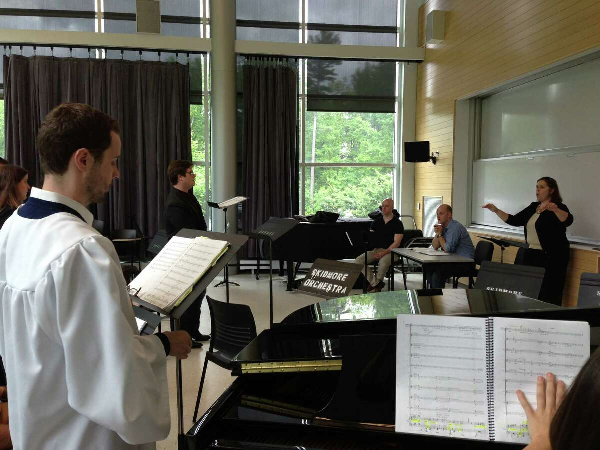 Conductor Laurie Rogers leads a rehearsal of