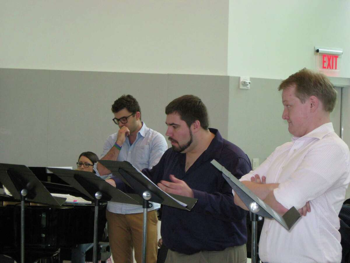 Opera Saratoga young artists James Judd, George Ross Somerville, Alex Soare, and pianist Sara Chiesa rehearse for the Roscoe Workshop. (Photo courtesy Curtis Tucker)