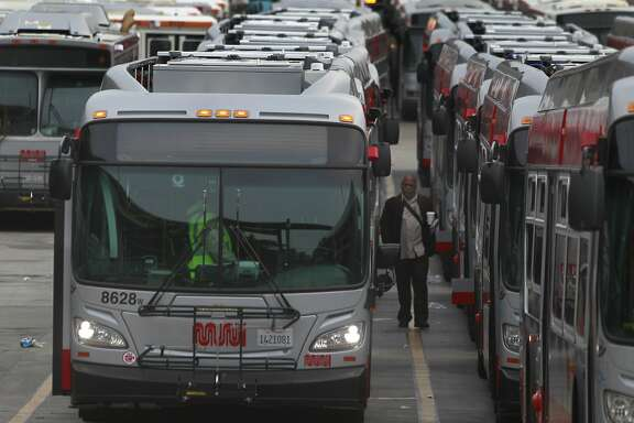 Drivers prepare for their runs at the bus yard at 23rd and Indiana streets on the third day of a sickout by Muni employees in San Francisco, Calif. on Wednesday, June 4, 2014. More workers reported for work today, but the system is still not operating at full capacity. The union employees are upset by a contract proposal made by MTA management.
