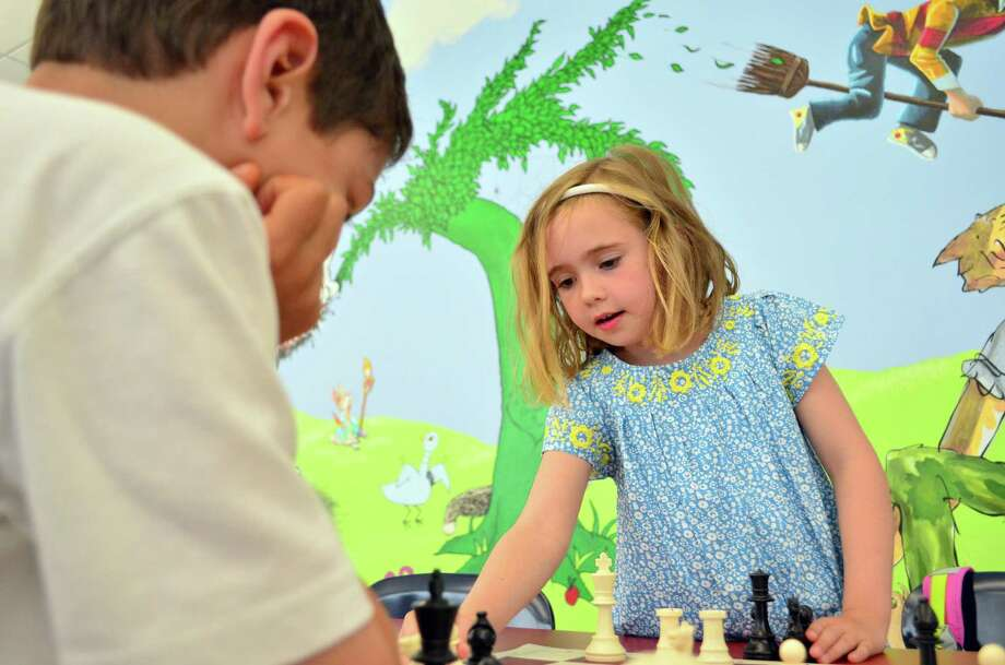 Catherine Vanderzee played chess against Malcolm Stewart at Tokeneke Elementary School at Darien After School. Photo: Megan Spicer / Darien News