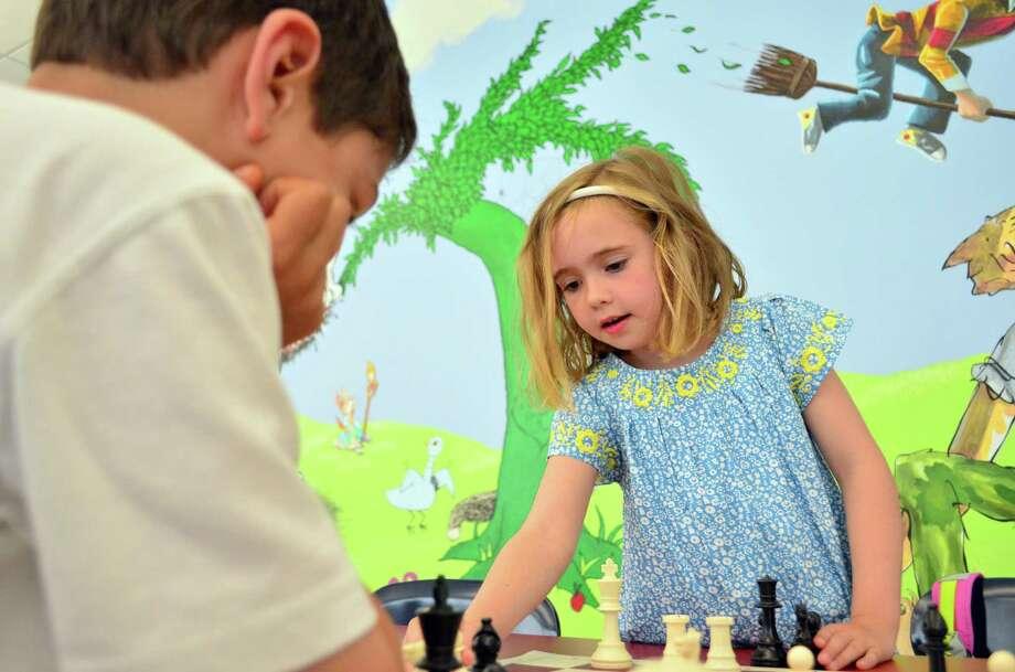 Catherine Vanderzee played chess against Malcolm Stewart at Tokeneke Elementary School at Darien After School. Photo: Megan Spicer / Darien News