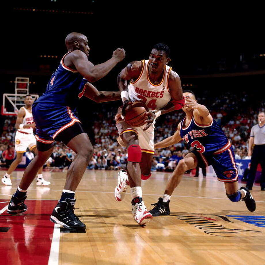 Game 1 - Wednesday, June 8, 1994Rockets 85, Knicks 78Houston leads series 1-0  Hakeem Olajuwon drives between against John Starks and Anthony Mason. Photo: Nathaniel S. Butler, NBAE/Getty Images / 1994 NBAE