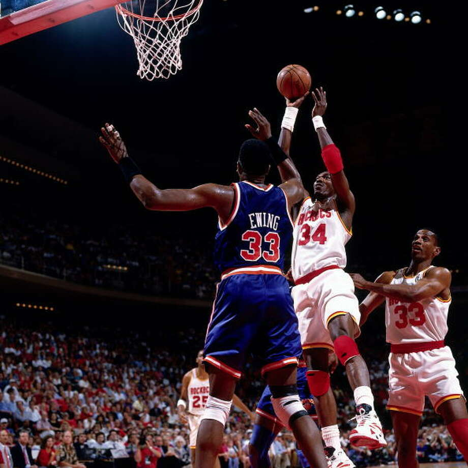 Game 1 - Wednesday, June 8, 1994Rockets 85, Knicks 78Houston leads series 1-0  Hakeem Olajuwon shoots a fallaway jump shot against Patrick Ewing. Photo: Nathaniel S. Butler, NBAE/Getty Images / 1994 NBAE