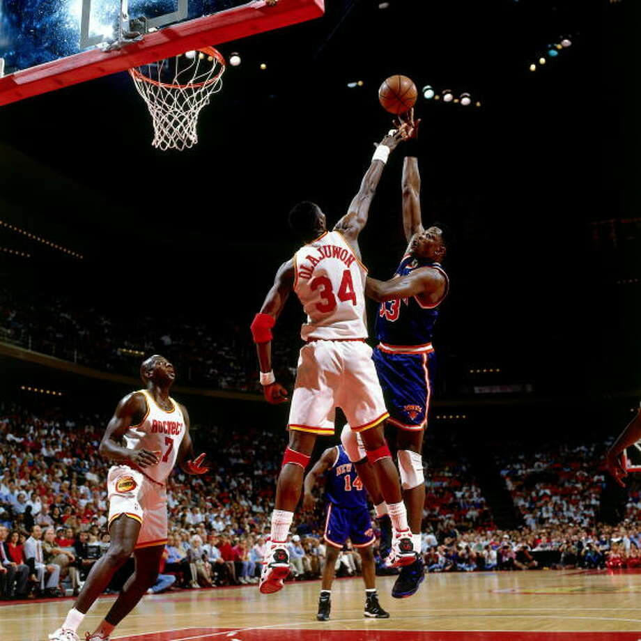 Game 1 - Wednesday, June 8, 1994Rockets 85, Knicks 78Houston leads series 1-0  Patrick Ewing shoots against Hakeem Olajuwon. Photo: Nathaniel S. Butler, NBAE/Getty Images / 1994 NBAE