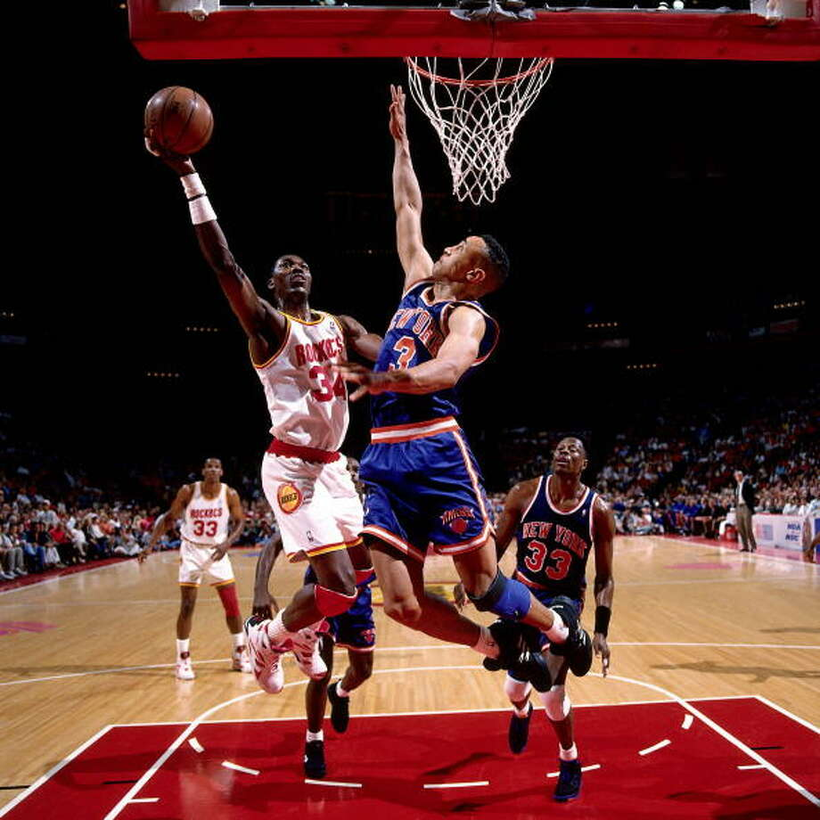 Game 2 - Friday, June 10, 1994Knicks 91, Rockets 83Series tied 1-1  Hakeem Olajuwon drives to the basket for a layup against John Starks. Photo: Nathaniel S. Butler, NBAE/Getty Images / 1994 NBAE