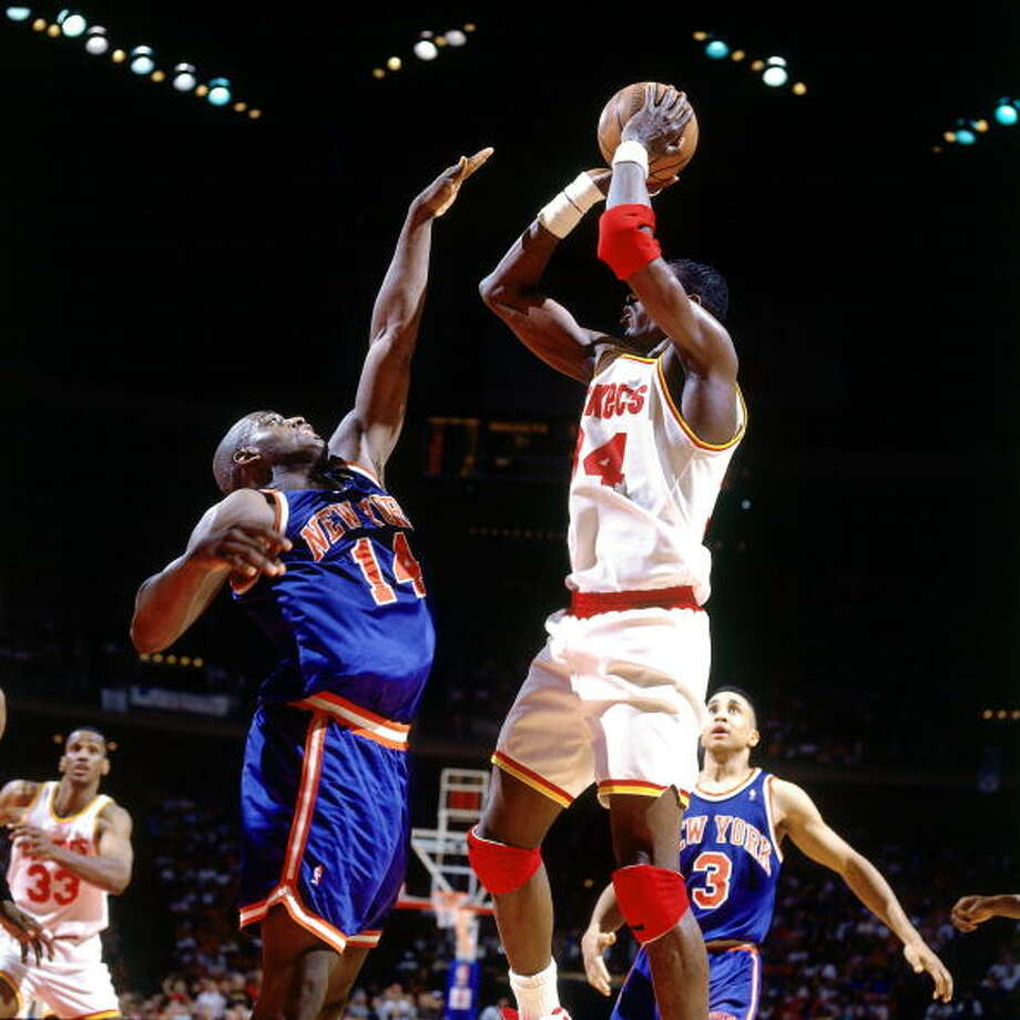 Game 2 - Friday, June 10, 1994Knicks 91, Rockets 83Series tied 1-1  Hakeem Olajuwon shoots against Anthony Mason. Photo: Nathaniel S. Butler, NBAE/Getty Images / 1994 NBAE