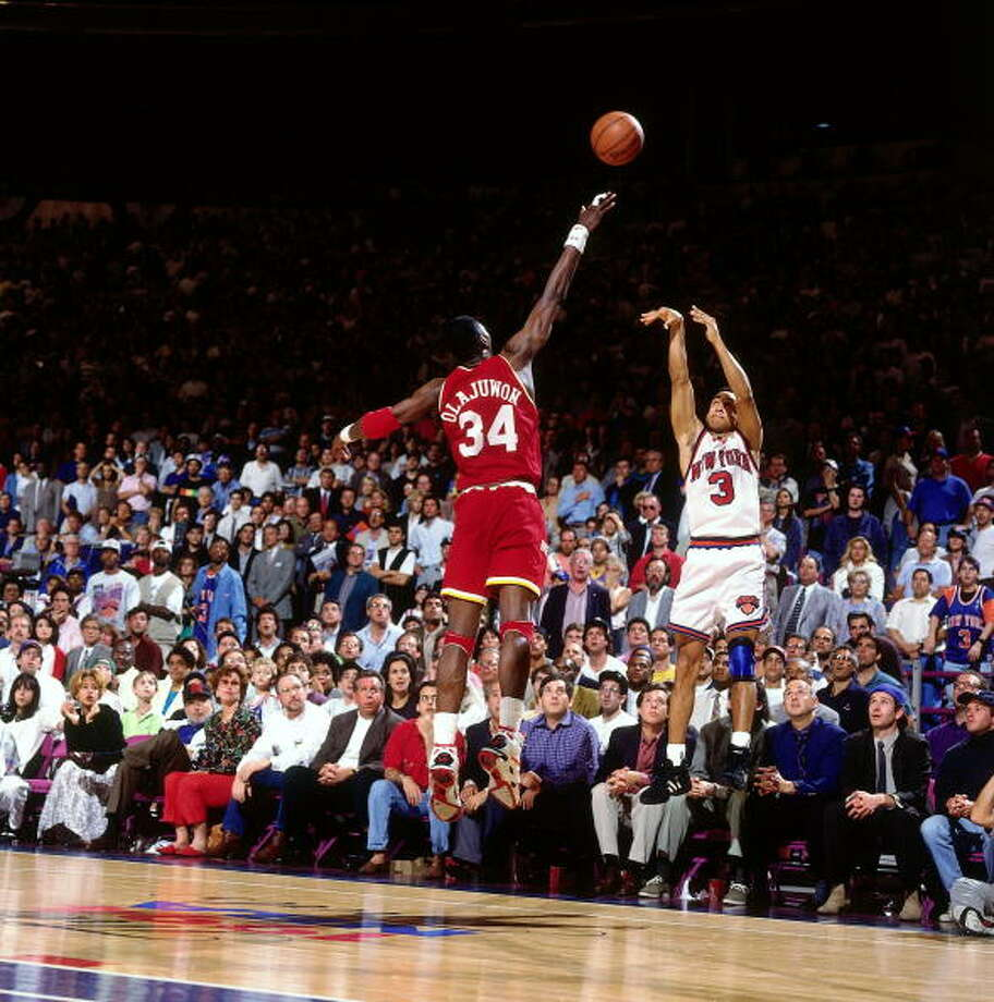 Game 3 - Sunday, June 12, 1994Rockets 93, Knicks 89Houston leads series 2-1  John Starks shoots over Hakeem Olajuwon. Photo: Nathaniel S. Butler, NBAE/Getty Images / 1994 NBAE