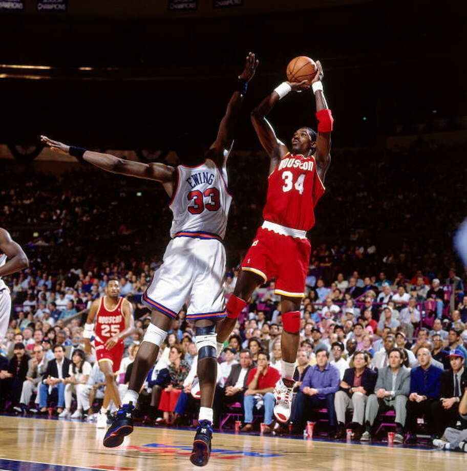 Game 3 - Sunday, June 12, 1994Rockets 93, Knicks 89Houston leads series 2-1  Hakeem Olajuwon shoots against Patrick Ewing. Photo: Nathaniel S. Butler, NBAE/Getty Images / 1994 NBAE