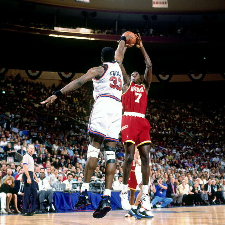 Game 3 - Sunday, June 12, 1994Rockets 93, Knicks 89Houston leads series 2-1  Carl Herrera shoots against Patrick Ewing. Photo: Andrew D. Bernstein, NBAE/Getty Images / 1994 NBAE