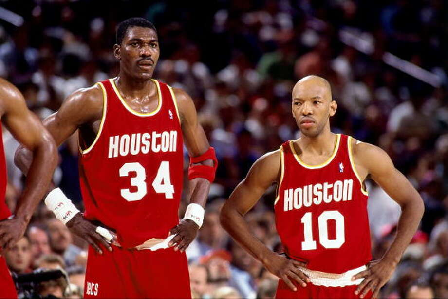 Game 4 - Wednesday, June 15, 1994Knicks 91, Rockets 82Series tied 2-2  Hakeem Olajuwon and Sam Cassell look on. Photo: Andrew D. Bernstein, NBAE/Getty Images / 1994 NBAE
