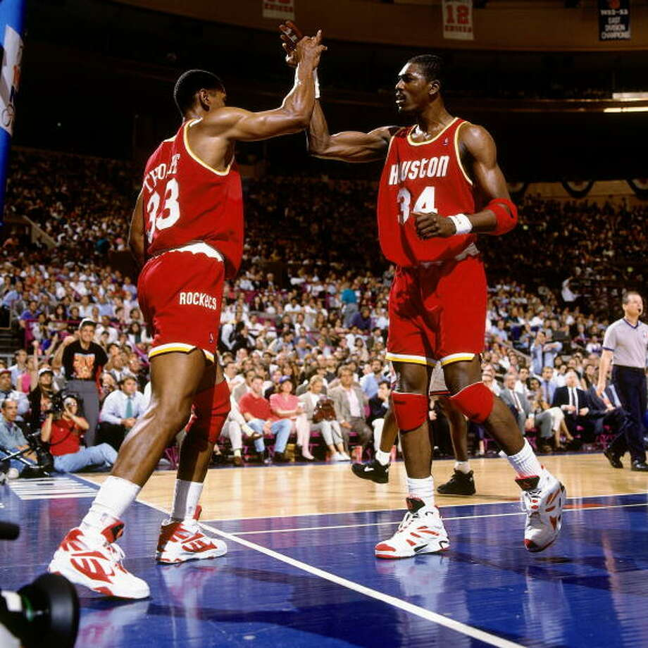 Game 4 - Wednesday, June 15, 1994Knicks 91, Rockets 82Series tied 2-2  Hakeem Olajuwon high fives Otis Thorpe. Photo: Andrew D. Bernstein, NBAE/Getty Images / 1994 NBAE