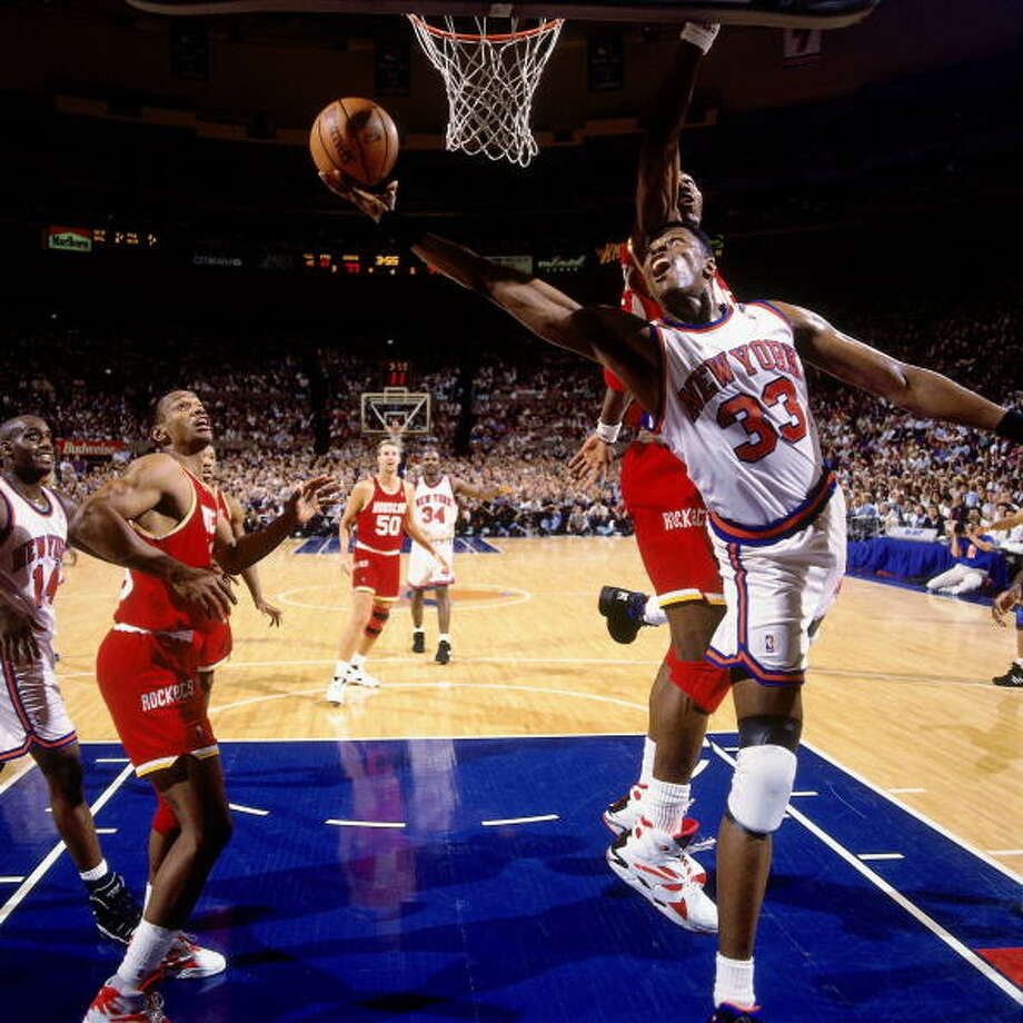 Game 4 - Wednesday, June 15, 1994Knicks 91, Rockets 82Series tied 2-2  Patrick Ewing shoots against Hakeem Olajuwon. Photo: Andrew D. Bernstein, NBAE/Getty Images / 1994 NBAE