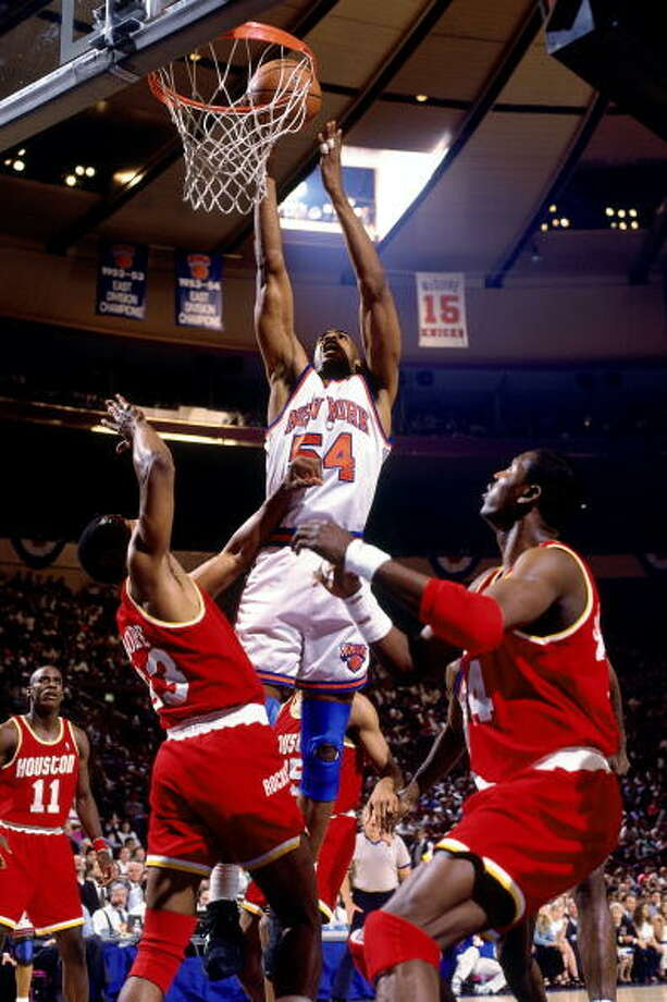 Game 4 - Wednesday, June 15, 1994Knicks 91, Rockets 82Series tied 2-2  Charles Smith dunks over Otis Thorpe. Photo: Andrew D. Bernstein, NBAE/Getty Images / 1994 NBAE