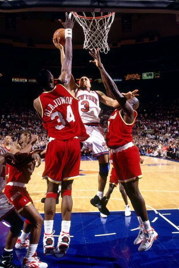 Game 4 - Wednesday, June 15, 1994Knicks 91, Rockets 82Series tied 2-2  John Starks shoots over Hakeem Olajuwon. Photo: Andrew D. Bernstein, NBAE/Getty Images / 1994 NBAE