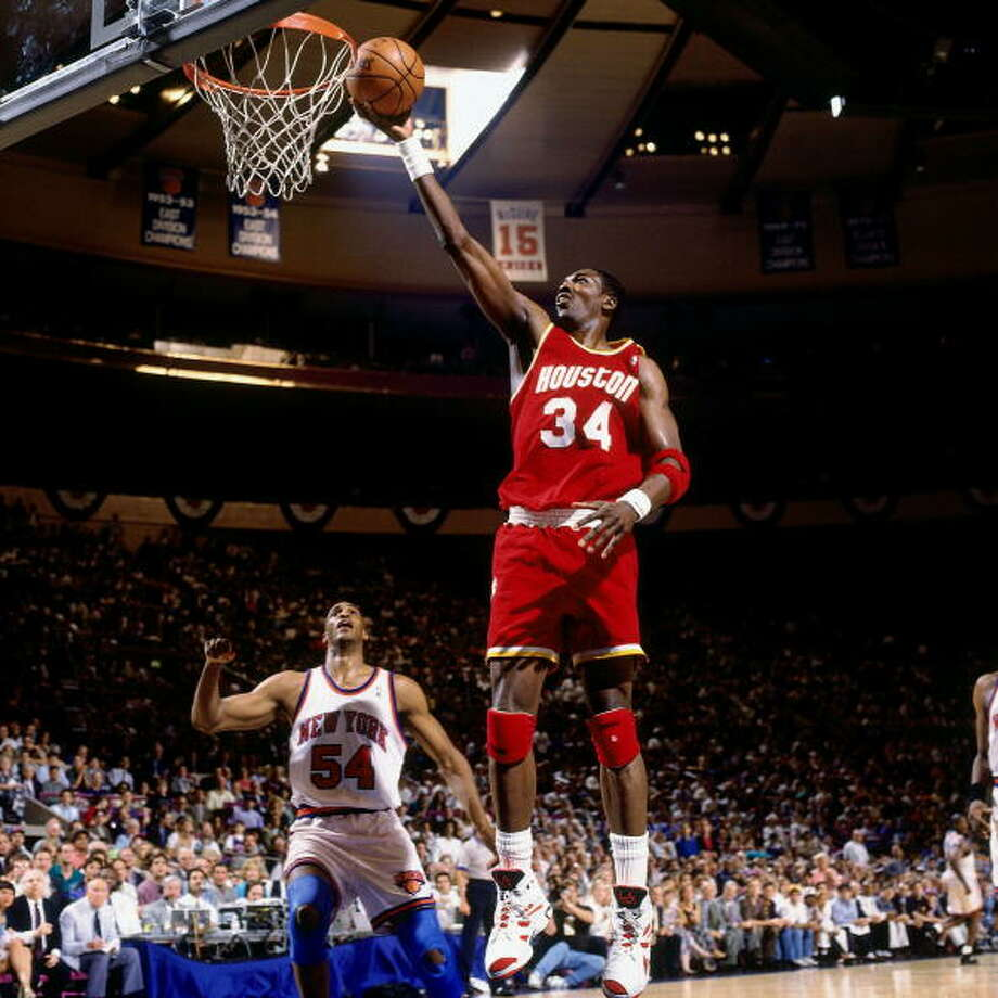Game 5 - Friday, June 17, 1994Knicks 91, Rockets 84New York leads series 3-2  Hakeem Olajuwon shoots against Charles Smith. Photo: Nathaniel S. Butler, NBAE/Getty Images / 1994 NBAE