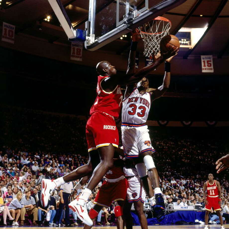 Game 5 - Friday, June 17, 1994Knicks 91, Rockets 84New York leads series 3-2  Carl Herrera puts up a shot against Patrick Ewing. Photo: Nathaniel S. Butler, NBAE/Getty Images / 1994 NBAE