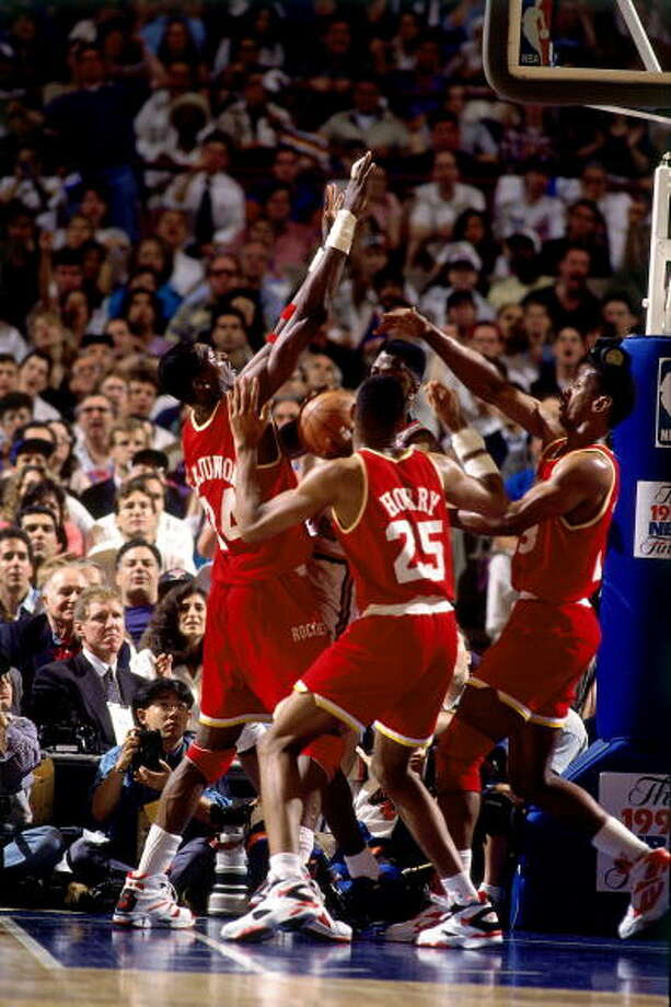 Game 5 - Friday, June 17, 1994Knicks 91, Rockets 84New York leads series 3-2  Patrick Ewing is triple teamed by Rockets defenders. Photo: Andrew D. Bernstein, NBAE/Getty Images / 1994 NBAE
