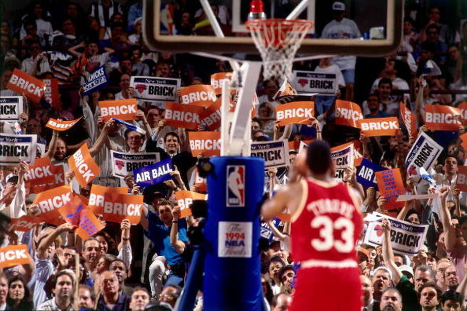 "Game 5 - Friday, June 17, 1994Knicks 91, Rockets 84New York leads series 3-2  Otis Thorpe shoots a foul shot while the fans hold up signs that read ""Brick."" Photo: Andrew D. Bernstein, NBAE/Getty Images / 1994 NBAE"