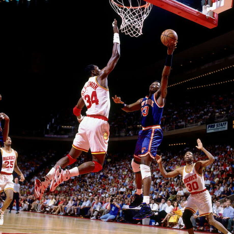Game 6 - Sunday, June 19, 1994Rockets 86, Knicks 84Series tied 3-3  Patrick Ewing puts up a shot against Hakeem Olajuwon. Photo: Andrew D. Bernstein, NBAE/Getty Images / 1994 NBAE