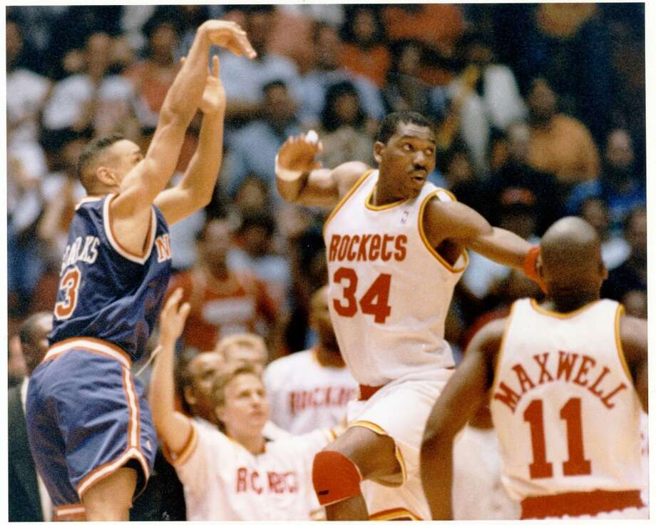 Game 6 - Sunday, June 19, 1994Rockets 86, Knicks 84Series tied 3-3  John Starks shoots the ball over Hakeem Olajuwon. Photo: Houston Chronicle
