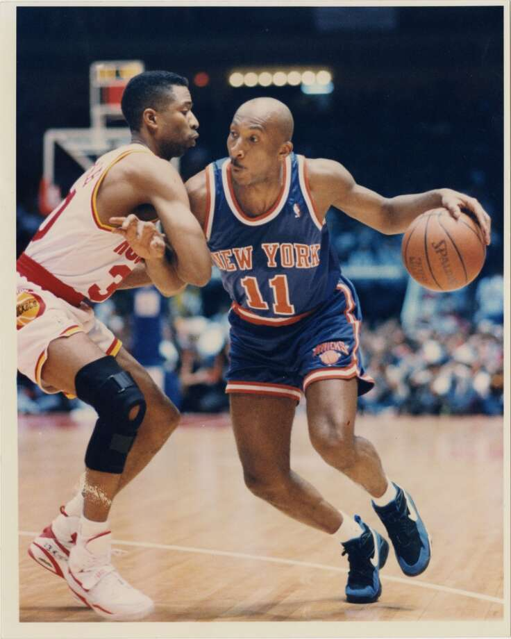 Game 6 - Sunday, June 19, 1994Rockets 86, Knicks 84Series tied 3-3  Derek Harper drives toward the basket against Kenny Smith in the second quarter. Photo: Ira Strickstein, Houston Chronicle