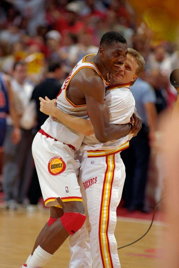 Game 7 - Wednesday, June 22, 1994Rockets 90, Knicks 84Rockets win series 4-3  Hakeem Olajuwon hugs teammate Scott Brooks after the Rockets won the title. Photo: Kerwin Plevka, © Houston Chronicle