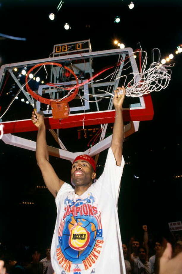 Game 7 - Wednesday, June 22, 1994Rockets 90, Knicks 84Rockets win series 4-3  Kenny Smith cuts down the net after winning the championship. Photo: Andrew D. Bernstein, NBAE/Getty Images / 1994 NBAE