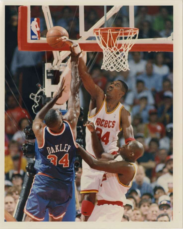 Game 7 - Wednesday, June 22, 1994Rockets 90, Knicks 84Rockets win series 4-3  Hakeem Olajuwon rejects a shot by Charles Oakley in the first quarter. Photo: John Makely, Houston Chronicle